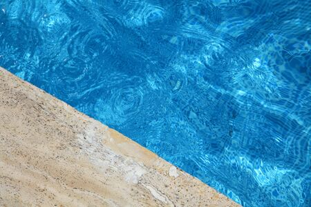 Edge of swimming pool and wave on a water surface Stock Photo - 5315957