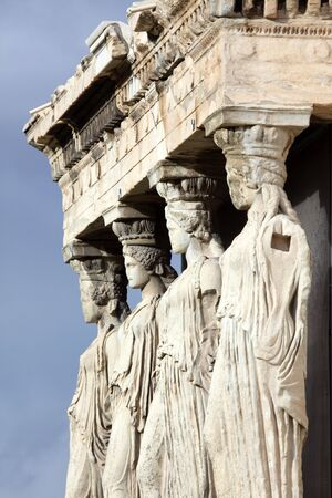 Erechtheum is an ancient Greek temple on the north side of the Acropolis of Athens in Greece Stock Photo - 6641441