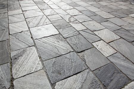 Sidewalk from stone tiles, grey color, horizontal photo