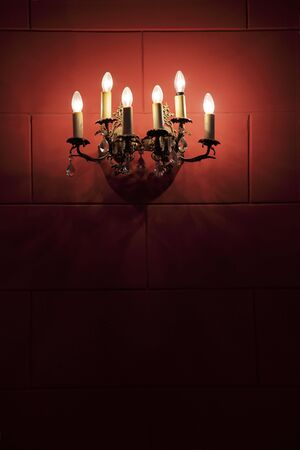 sconce: Sconce on a wall