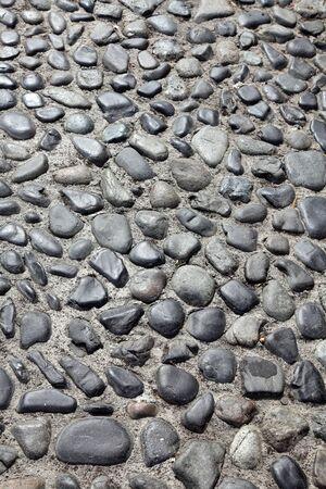 Cobblestone road as a vertical background Stock Photo - 8580626