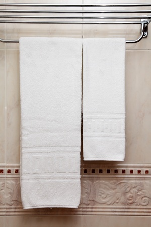 Pure white towel on a hanger photo