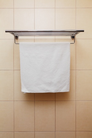 Clean white towel on a hanger photo