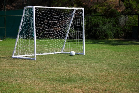 soccer goal: Football goal, ball on a green grass Stock Photo
