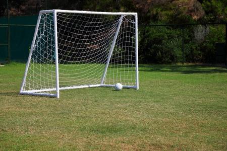 Football goal, ball on a green grass Stock Photo