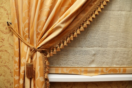 yellow tassel: Fragment of a beautiful curtain of yellow color