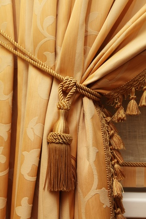 Fragment of a beautiful curtain of yellow color