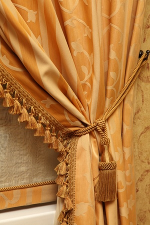 Fragment of a beautiful curtain of yellow color photo