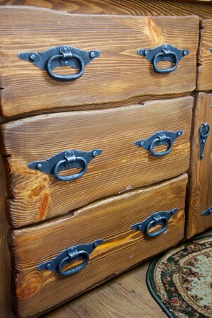 drawers with metal handles, close-up photo