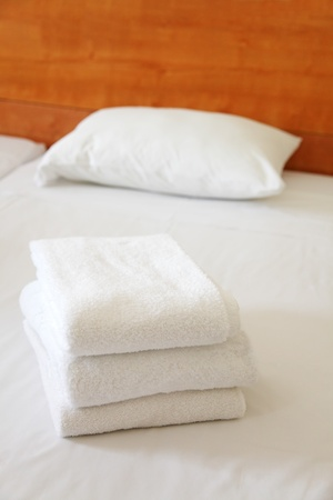 three towels on the beds in the hotel Stock Photo - 13011587