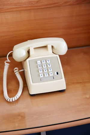 'bedside table': phone on the bedside table in the bedroom