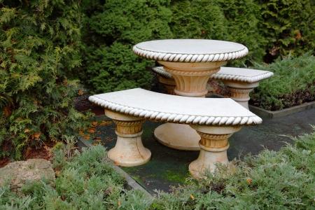 garden bench: a stone table and benches in the garden