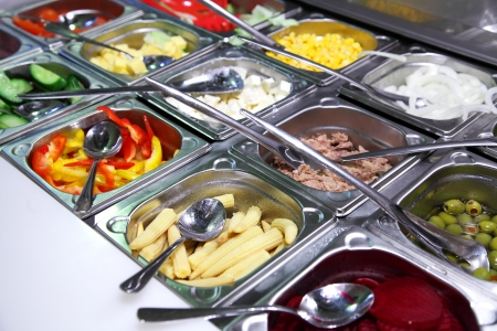horizontal bar: salad bar with vegetables in the restaurant
