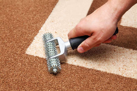 installer: installation of carpet, the installer does the seams Stock Photo