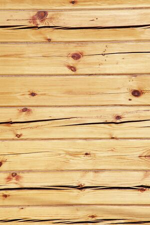 uneven: wall of the wooden squared beam with cracks