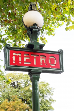 street lamps: sign metro station on the street of Paris Stock Photo