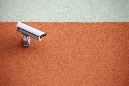 building security: video camera security system on the wall of the building Stock Photo