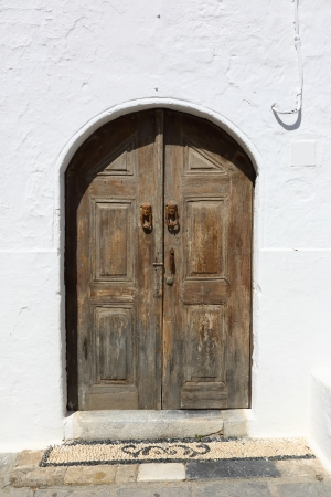 old wooden door in a white wall Stock Photo - 23073753