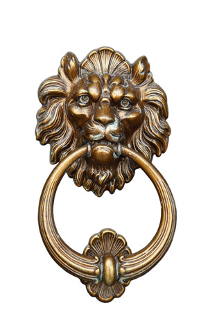 old door handle with the head of a lion and an iron ring photo
