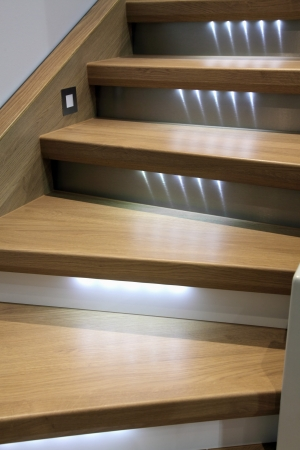 led lighting: wooden stairs with led backlight Stock Photo