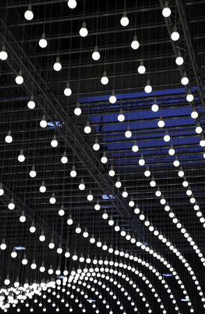 lamp shade: a lot of light bulbs hanging on the ceiling