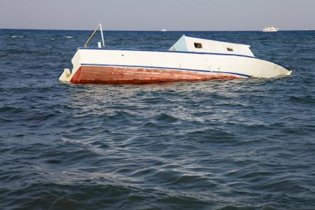 sunken boat: sunken boat in the sea Stock Photo