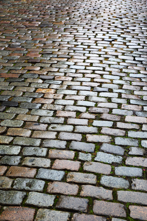 footway: old paving stone on city road Stock Photo