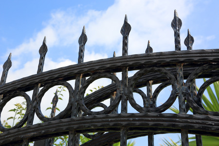 sturdy: sturdy iron fence with sharp peaks Stock Photo