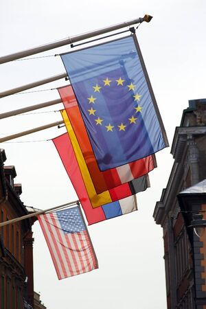 different countries: flags of different countries hung on the building Stock Photo