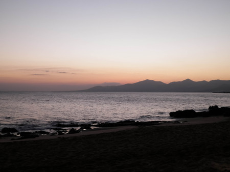Beautiful sunset on beach in Puerto del Carmen, Lanzarote, Canary Islands. Travel and nature concept.