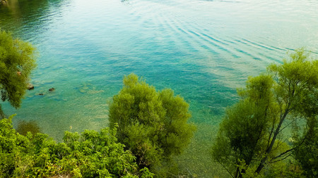 Beautiful water of Lake Ochrid as nature background. Ochrid is the oldest lake in Europe. High cliffs and mediterranean nature.