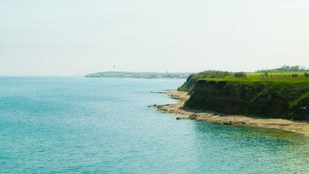 Cliffs on the Black Sea coas. Landscape of cliffs and beach in Vama Veche, Dobrogea region, Romania. Nature and traveling concept.