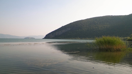 Coast of Lake Prespa and Mountains of Galicica National Park. Prespa is situated between Macedonia, Greece and Albania, known of it's wild nature and pelican reserve.