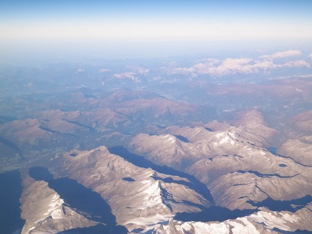 Horizon of the planet earth and Alps mountain tops. View from spaceship or plane.