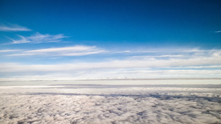 Cloudscape form plane. Flying above the clouds. 免版税图像