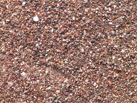 Sand and gravel on a seashore as nature background. Copy space. 스톡 콘텐츠