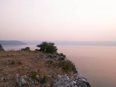 Beautiful sunset over Lake Ochrid. Macedonia. Travel and nature concept.