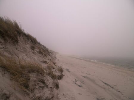 Coastal area at cold, foggy day in Lazy. Stormy weather on Baltic sea coast, Northern Poland. Stock fotó