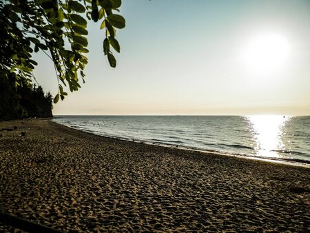 Beautiful view of sunset over Baltc Sea and it's sandy beach in Gdynia, Poland. Nature and travel concept.
