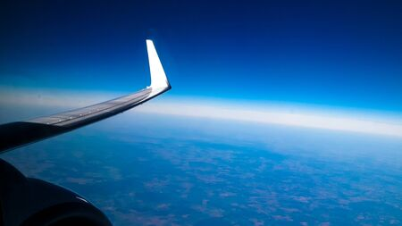 View from plane window on Planet Earth, plane enginie and wing. Travel and transport concept.