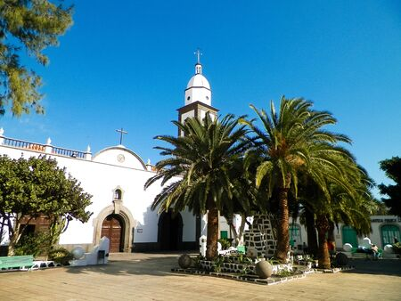 Catholic church in Yaiza, Lanzarote island. Tropical climate, architecture, religion and tourism concept.