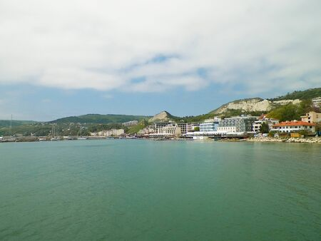 View on marina and coast of Balchik, Bulgaria. Stormy weather over Black sea coast, traveling and nature concept.