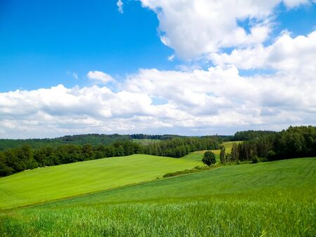 Hills and fields of Wiezyca Kashubia region, Poland. Travel and nature concept.