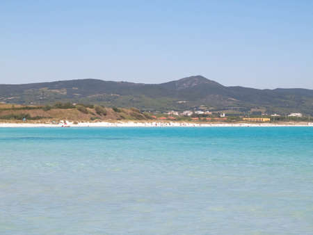 Coast and beach in Vada, Italy. Transparent, turquoise water and white sand. Travel and nature concept. Stockfoto