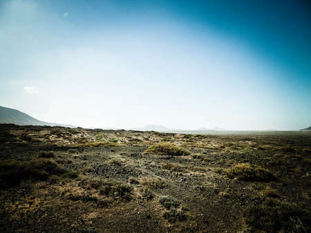 Desert landscape, Lanzarotte, Canary Islands. Desert is typical landscape on Lanzarote island. Travel and nature concept. 版權商用圖片