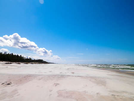 Sandy beach in Stilo, Poland. Baltic Sea coast. copy space on blue sky.