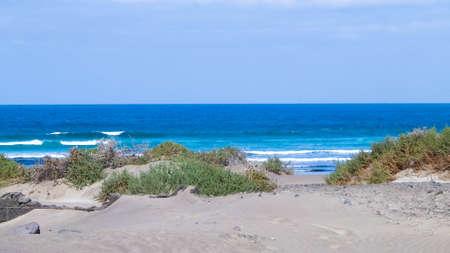 Beach and Atlantic Ocean in Caleta de Famara, Lanzarote Canary Islands. Beach in Caleta de Famara is very popular among surfers. Copy space. Banque d'images