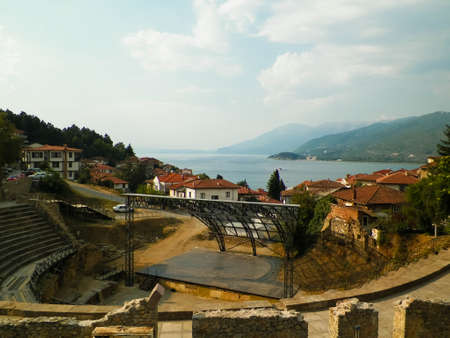 Old town in Ochrid City, amphitheater and water of Ochrid Lake as background. Architecture and tourism concept. Ohrid is one of only 28 sites that are part of UNESCO's World Heritage that are Cultural as well as Natural sites.