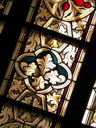 Stained glass as architecture background. Arch-see in Frombork. Art background. St. Andrew in Frombork Cathedral.
