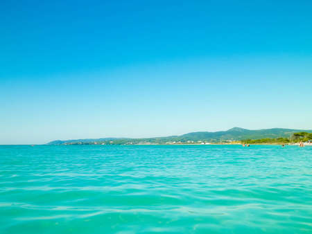 Sea and coast of Vada, Italy. Transparent, turquoise water and white sand. Travel and nature concept.